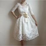 vestido de noiva curto de renda e com manga