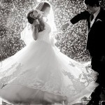 Noiva e Noivo dançando na chuva - Bridal Guide